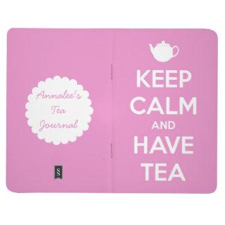 Behalten Sie ruhig und haben Sie Tee-rosa Taschennotizbuch