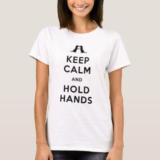 Behalten Sie ruhig und halten Sie Hände (die T-Shirt