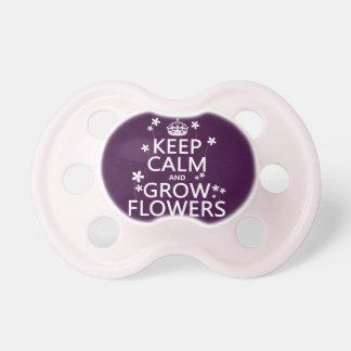Behalten Sie ruhig und wachsen Sie Blumen (in Schnuller