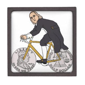 Ben Franklin auf einem Fahrrad mit Dollar-Rädern Schmuckkiste