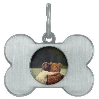 Beste Freunde ein kleines Mädchen und ihr Teddybär Tiermarke