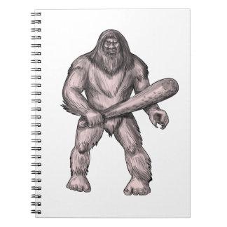 Bigfoot, der Verein-stehende Tätowierung hält Spiral Notizblock