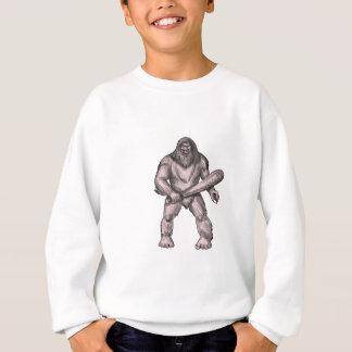 Bigfoot, der Verein-stehende Tätowierung hält Sweatshirt