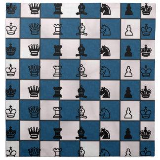 Blau u. Weiß gemarmortes Schach-Brett u. Stücke Serviette