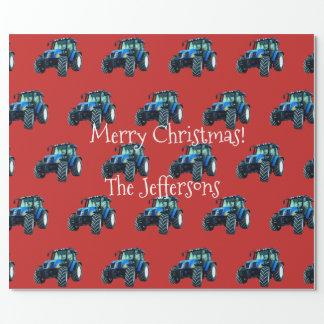 Blaue Ackerschlepper auf rotem Weihnachten Geschenkpapier