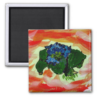 Blaue Blumen im rotes Seemagneten Quadratischer Magnet