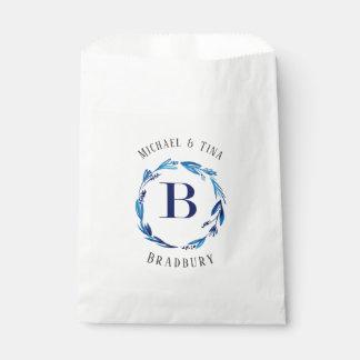 Blaue Blumenmonogramm-Bevorzugungs-Tasche des Geschenktütchen