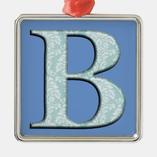 Blaue Blumenmonogramminitialen des damast-Druckes Quadratisches Silberfarbenes Ornament