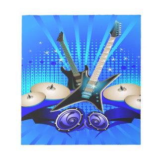 Blaue elektrische Gitarren, Trommeln u. Notizblock