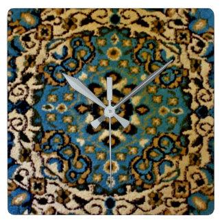 Blaue orientalische Wolldecke Quadratische Wanduhr