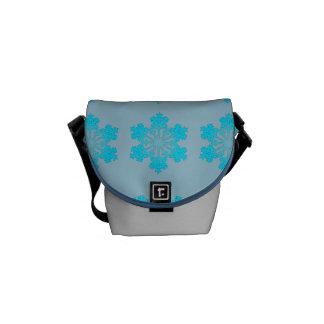 Blaue Schneeflocke-Minibote-Tasche Kuriertasche