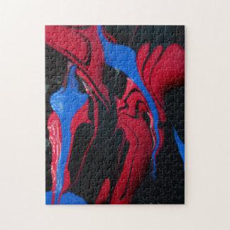Blaue und rote Farbe auf Schwarzem Puzzle