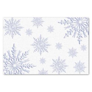 Blaue Winter-Schneeflocken auf Weiß Seidenpapier