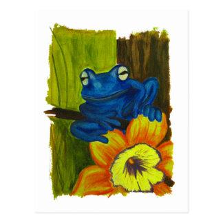 Blauer Frosch, der auf Blumen- und Postkarte