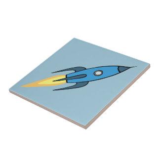 Blauer Retro Rocketship niedlicher Cartoon-Entwurf Fliese