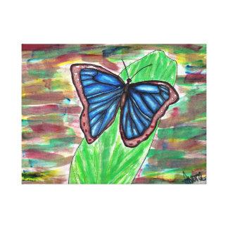 Blauer Schmetterling auf Blatt Leinwanddruck