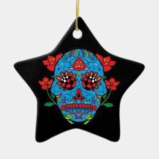 Blauer Zuckerschädel mit roten Augen und Keramik Ornament