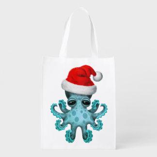 Blaues Baby-Krake, die eine Weihnachtsmannmütze Wiederverwendbare Einkaufstasche