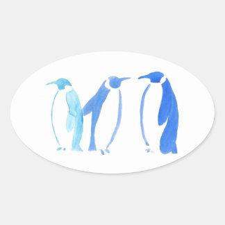 Blaues Pinguin-Trio Ovaler Aufkleber
