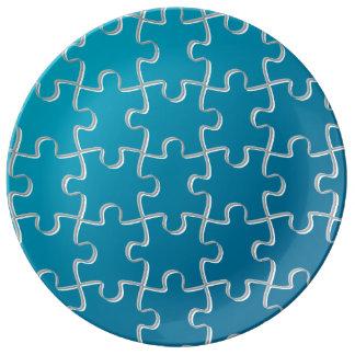 Blaues Puzzlespielmuster Porzellanteller