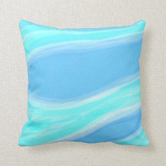 Blaues und cyan-blaues Kissen