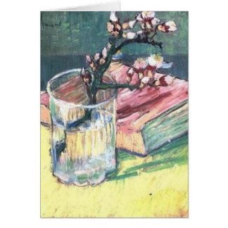 Blühende Mandel verzweigen sich in ein Glas und in Karte
