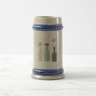 Blumen in den Flaschen Bierglas