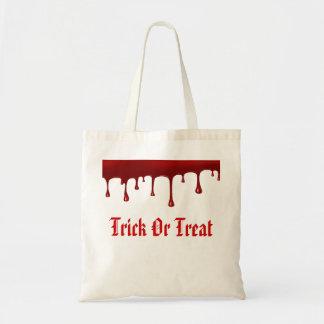 Blut, das Halloweentrick oder -Leckerei tropft Tragetasche