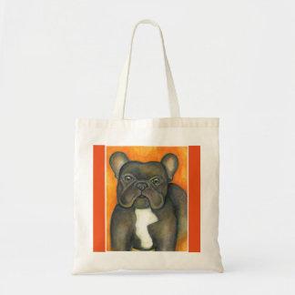 Brindle französische Bulldogge mit orange Tasche