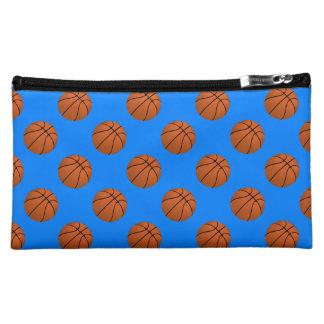 Brown-Basketball-Bälle auf azurblauem Blau Kosmetiktasche