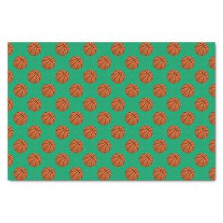 Brown-Basketball-Bälle auf Kleeblatt-Grün Seidenpapier