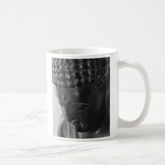 Buddha stellen, Buddha gegenüberstellen gegenüber Kaffeetasse