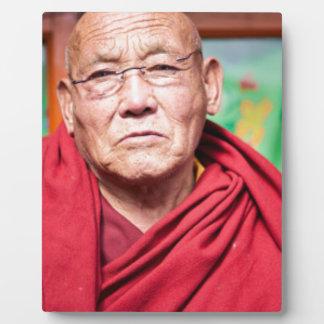 Buddhistischer Mönch in der roten Robe Fotoplatte