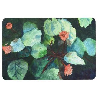 Bunte tropische Lilien in der Wasser-Boden-Matte Bodenmatte
