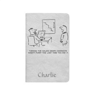 Büroangestellter dreht Verkaufsdiagramm seitlich Taschennotizbuch