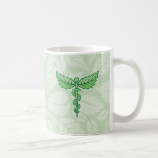 Caduceus mit Blätterhintergrund Kaffeetasse