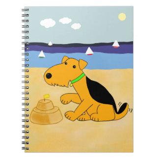 Cartoonairedale-Terrier-Hund am Strand-Notizbuch Spiral Notizblock