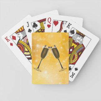 Champagne-Glas-Feier auf funkelndem Gold Spielkarten