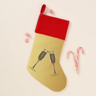 Champagne-Glas-Feier auf Gold Weihnachtsstrumpf