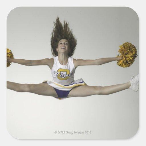 Cheerleader, die Spalten in der mittleren Luft tut Aufkleber