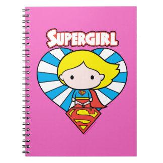 Chibi Supergirl Sternexplosion-Herz und Logo Spiral Notizblock