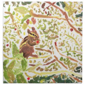 Chipmunk, der Servietten eines Beerenstoffes isst