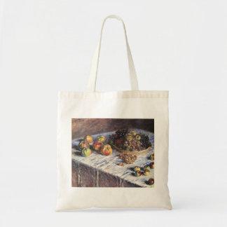 Claude Monet-Stillleben mit Äpfeln und Trauben Tragetasche