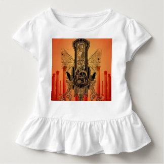 Clef auf einem dekorativen Knopf Kleinkind T-shirt