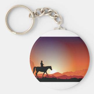 Cowboy, der ein Pferd Keychain reitet Schlüsselanhänger