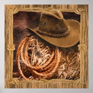Cowboyhut und Lariat auf Strohballen Poster