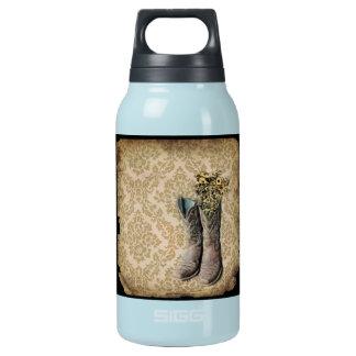 Damast-Wildblume Westernland-Cowboystiefel Isolierte Flasche