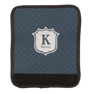 Das Monogramm der hübschen dunklen Gepäck Markierung