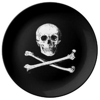 Dekorative Platte des Totenkopfs mit gekreuzter Teller