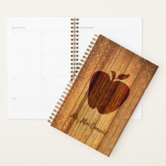Dekoratives Holz mit Apple-Lehrer-täglichem Planer